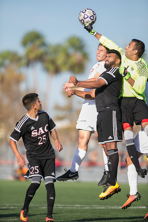 Santa Ana College Goalkeeper Sergio Candelas defends the goal during a corner kick in the 2nd half of their game against Orange Coast College. 11/4/16-4:09:53 PM