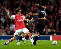 Photo: Ed Godden/Sportsbeat Images.<br /> Arsenal v Sevilla. UEFA Champions League Group H. 19/09/2007. Arsenal's Tomas Rosicky (L), tussles with Daniel Alves.