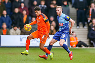 Luton Town defender James Justin controls the ball in front of Wycombe Wanderers defender Jason McCarthy during the EFL Sky Bet League 1 match between Luton Town and Wycombe Wanderers at Kenilworth Road, Luton, England on 9 February 2019.