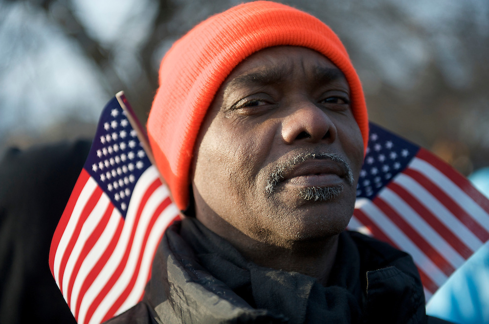 A man concentrates on Barack Obama's inaugural address on the historic occassion of his Presidential inauguration.  An estimated two million people flocked to Washington D.C. for the ceremony, enduring freezing temperatures to witness Obama take the oath of office becoming the first African-American to become President, the 44th in the history of the United States of America.