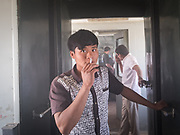 Cigarette break. Life inside the train - mostly Muslim Uighur people  ride this train.