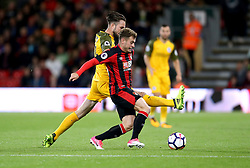AFC Bournemouth's Ryan Fraser (right) and Brighton & Hove Albion's Davy Propper (left) battle for the ball