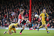 Brentford attacker, Sergi Canos (47) getting fouled but denied a penalty during the Sky Bet Championship match between Brentford and Fulham at Griffin Park, London, England on 30 April 2016. Photo by Matthew Redman.