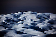 """Ice dunes on Petermann Glacier, in remote northwestern Greenland, on Nares Strait, near Canada's Ellesmere Island.  Photographed during a 2009 Greenpeace expedition to investigate the effects of climate change in the Arctic. In 2010 and 2012 Petermann calved ice islands totalling 400 square kilometres. This mage can be licensed via Millennium Images. Contact me for more details, or email mail@milim.com For prints, contact me, or click """"add to cart"""" to some standard print options."""