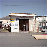 """Masiphumelele is a township in the South of Cape town, from 25000 to 30000 people live there. Settlement also known as """" site 5 """" it was regularly pulled down during the Apartheid. The inhabitants renamed the township """"Masiphumelele"""" which is a Xhosa word meaning """"We will succeed""""."""