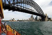 View of Sydney Harbour Bridge and Sydney Opera House from deck of Sydney Harbour Ferry. Sydney, Australia