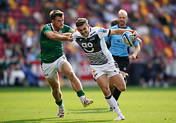 London Irish's Ben White (left) and Sale Sharks' Raffie Quirke during the Gallagher Premiership match at the Brentford Community Stadium, London. Picture date: Sunday September 26, 2021.