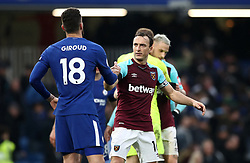 Chelsea's Olivier Giroud (left) and West Ham United's Mark Noble shake hands after the final whistle