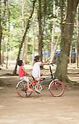 Children riding bicycle, Red Island, Banyuwangi Regency, East Java, Indonesia, Southeast Asia