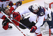 USA forward David Backes (42) hits Canada forward Patrick Sharp (10) in the second period of a men's hockey semifinal at Bolshoy Ice Dome during the Winter Olympics in Sochi, Russia, Friday, Feb. 21, 2014. (Brian Cassella/Chicago Tribune/MCT)