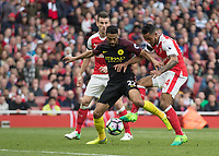 Football - 2016 / 2017 Premier League - Arsenal vs. Manchester City.<br /> <br /> Theo Walcott of Arsenal gets a shot in between the legs of Gael Clichy of Arsenal to equalise for his team at The Emirates.<br /> <br /> COLORSPORT/DANIEL BEARHAM