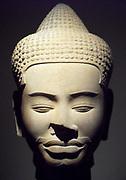 Head of Buddha. 11th century style Baphuon (1050-1100) sandstone Sculptor Ta Prohm (temple) Cambodia