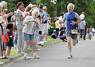 Middletown, New York - Andrew Warren of Middletown heads for the finish line in the 15th annual Ruthie Dino Marshall 5K Run and Fun Walk hosted by the Middletown YMCA on Sunday, June 5, 2011. Warrren won the men's 50-59 age group. ©Tom Bushey / The Image Works