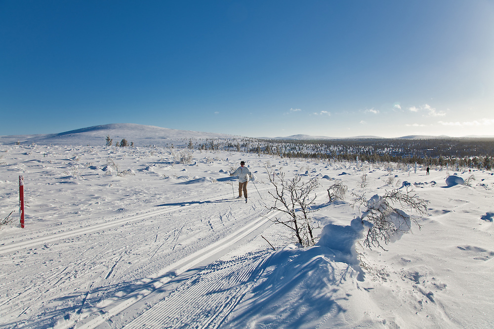 Skiers are rising to the open fells in Lapland, Finland. The mountains in Finnish Lapland reach heights of up to 400 and 800 metres, where the upper reaches are above the tree line.
