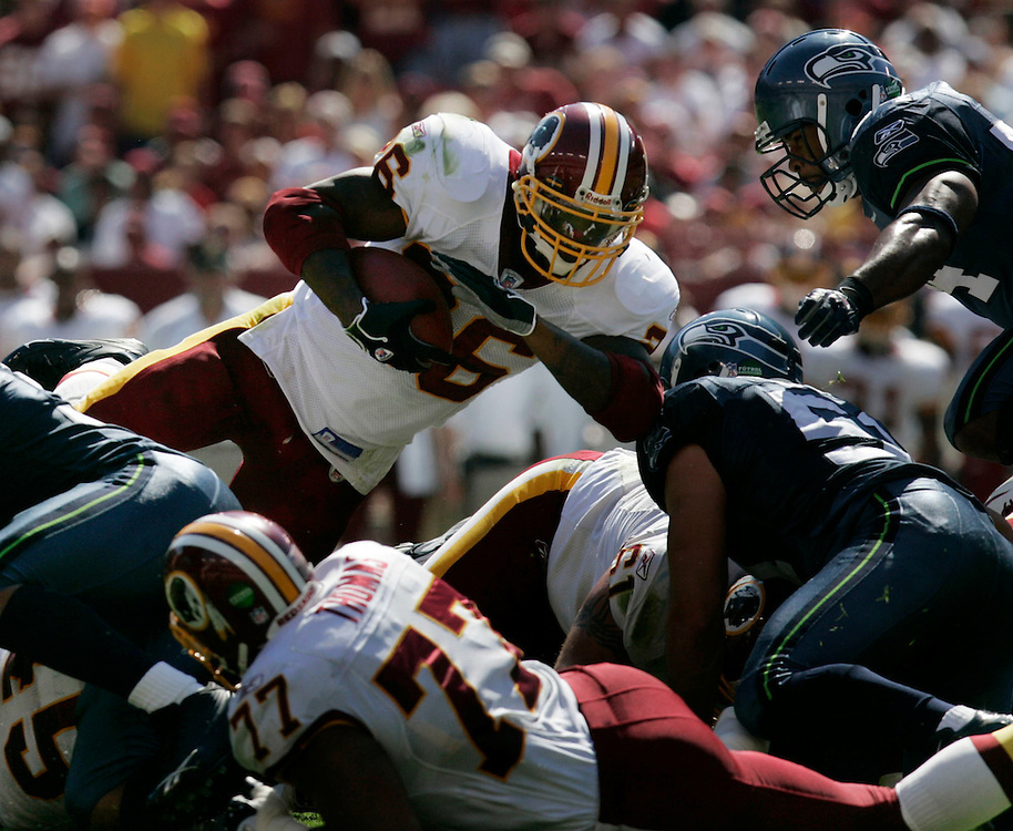 Jay Westcott/Examiner   SP   Oct. 2, 2005 -  Washington Redskins vs. Seattle Seahawks - #26 Clinton Portis leaps over the pile in the 2nd Quarter for a crucial 1st down.