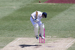 © Licensed to London News Pictures. 04/01/2014. Stuart Broad jumps in the air to avoid a bouncer during day 2 of the 5th Ashes Test Match between Australia Vs England at the SCG on 4 January, 2013 in Melbourne, Australia. Photo credit : Asanka Brendon Ratnayake/LNP