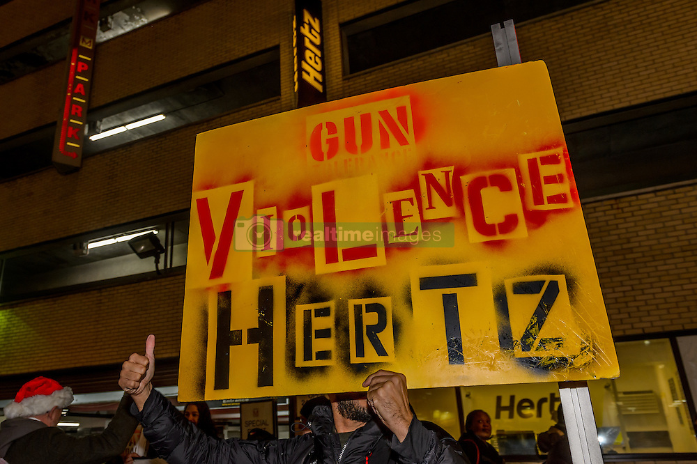 November 28, 2016 - New York, United States - Protest at Hertz location in Midtown Manhattan - In a protest at FedEx, Hertz, and Wyndham Worldwide locations in Midtown Manhattan, Gays Against Guns, a direct action group committed to end gun violence in America, will demand that the three companies halt their generous discounts for NRA members because some of the money that NRA members save with FedEx, Hertz, and Wyndham ends up in the NRA's bank account. That same NRA bank account siphons money straight to the gun lobby's bank account. (Credit Image: © Erik Mcgregor/Pacific Press via ZUMA Wire)