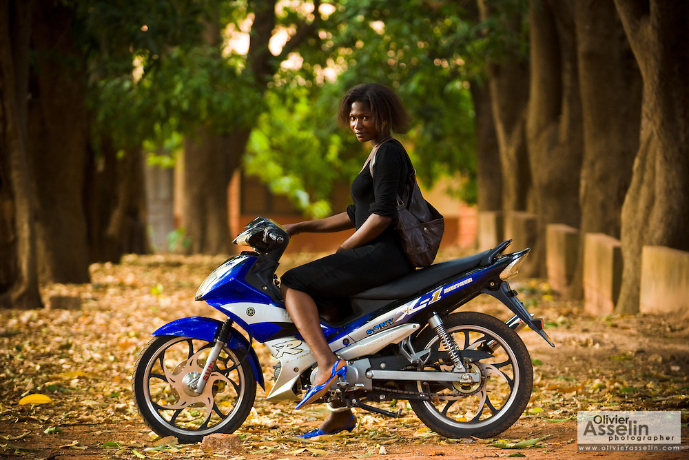 Abibata Ouarmé, 24, a victim of female genital mutilation who wants to undergo surgery to have her clitoris restored, poses for a portrait on her moped in Bobo-Dioulasso, 365 kilometres west of Burkina Faso's capital Ouagadougou on Monday May 4, 2009. Abibata is waiting for a hospital, funded by NGO Clitoraid, to become operational before she can receive the procedure free or charge.