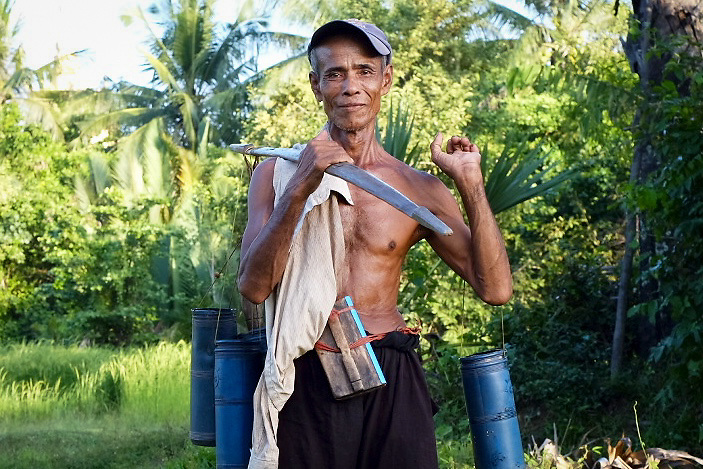 This Man is a sugar collector from Kampot, Cambodia. Every day, from november untill may he climb more than 20 trees to collect the sweet juice from the flowers of the Borassus Flabellifer palm wich is widely used in the country for the production of sugar.
