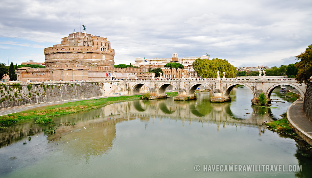 ROME, Italy - The historic Castel Sant'Angelo, historically a jail, in Rome, Italy, with the Tiber River in the foreground.