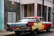 Old multi-colored, car in Ciego de Avila, Cuba.