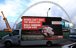 """Activist group Avaaz with a billboard truck reading """"Russia can't host the World Cup while bombing Syrian kids"""" outside Wembley Stadium, as part of a campaign for the 2018 World Cup to be relocated from Russia, ahead of the international friendly match between England and Italy."""