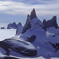 ANTARCTICA, Queen Maud Land.  Fenris Mountains. 2721m Kinntanna and Stetind (R) Sigyn Glacier foreground.