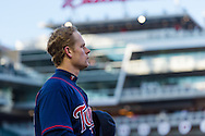 Justin Morneau #33 of the Minnesota Twins looks on during the national anthem before Game 2 of a split doubleheader against the Miami Marlins on April 23, 2013 at Target Field in Minneapolis, Minnesota.  The Marlins defeated the Twins 8 to 5.  Photo: Ben Krause