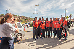 The team poses to take a picture outside of Cyril E. King airport.  The ladies of the University of Virginia's Basketball Team arrive for the Paradise Jam Tournament  in St. Thomas at Cyril E. King Airport.  24 November 2015.  © Aisha-Zakiya Boyd