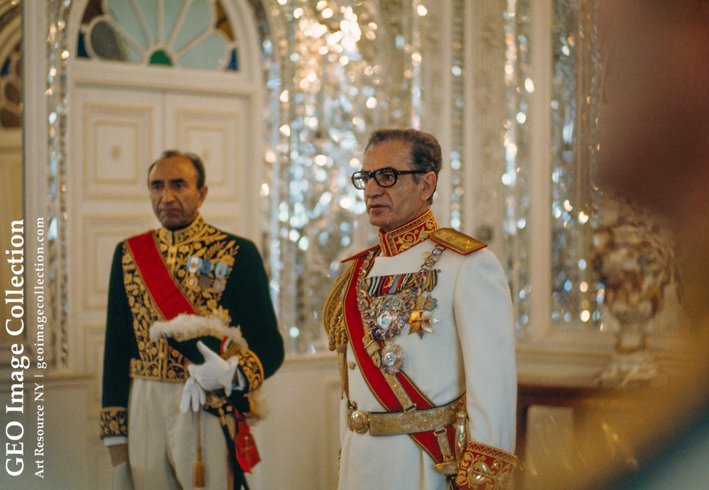 The Shah of Iran waits in full regalia to greet heads of state.