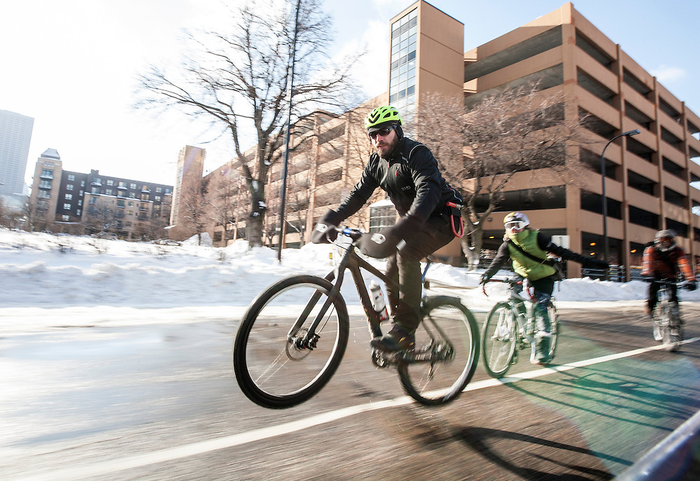 A racer catches some air on his way to Nicollet Island for the start of Stupor Bowl 17 in Minneapolis February 1, 2014.