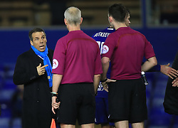 Birmingham City manager Gianfranco Zola looks to speak to referee Chris Kavanagh (right) after the final whistle