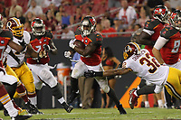 28 August 2014: Tampa Bay Buccaneers running back Jeff Demps (32) runs thru a diving tackle attempt from Washington Redskins defensive back Da Mon Cromartie-Smith (32) during the NFL American Football Herren USA Preseason game between the Washington Redskins and Tampa Bay Buccaneers at Raymond James Stadium in Tampa, Florida. NFL American Football Herren USA AUG 28 Preseason - Redskins at Buccaneers PUBLICATIONxINxGERxSUIxAUTxHUNxRUSxSWExNORxONLY Icon0828201401003<br />