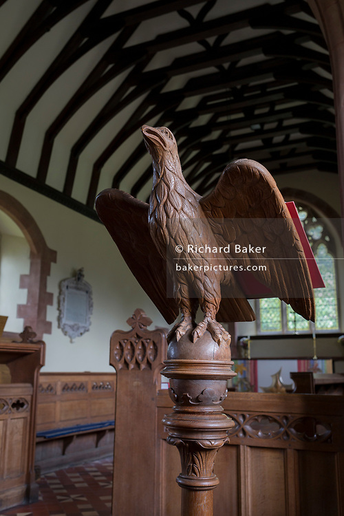 The carved wooden eagle lectern in to St. Michael and All Angels church, on 10th September 2018, in Lingen, Herefordshire, England UK.