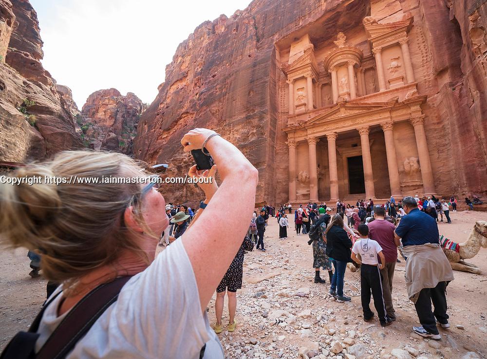 Tourist photographs The Treasury (Al Khazneh), at Petra, Jordan, UNESCO World Heritage Site