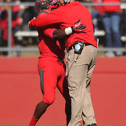 Oct 13, 2012: Rutgers Scarlet Knights defensive back Duron Harmon (32) celebrates with head coach Kyle Flood after he breaks up a fourth down pass on the goal line during NCAA Big East college football action between the Rutgers Scarlet Knights and Syracuse Orange at High Point Solutions Stadium in Piscataway, N.J.