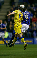 Photo: Steve Bond.<br />Leicester City v Leeds United. Coca Cola Championship. 13/03/2007. Frazer Richardson (left) contests the ball with Geoff Horsfield (right)
