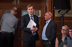 © Licensed to London News Pictures. 14/04/2016. London, UK. Seumas Milne (left) and Kevin Slocombe (right) advisors to Jeremy Corbyn, attend a speech by the leader of the Labour Party, arguing the case for Britain remaining in Europe, at Senate House in London. The Uk is due to vote in and in out referendum in their membership of the EU on June 23rd, 2016.  Photo credit: Ben Cawthra/LNP