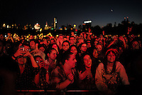 Fans watch as John Mayer takes the stage at the Global Citizen's Festival in New York's Central Park. <br /> <br /> The free, ticketed event is part of the Global Citizen platform, a social media and live-event campaign. Musicians and celebrities join dignitaries and philanthropists to urge world leaders to act towards ending extreme poverty by 2030. Free tickets were earned by fans who logged on to www.globalfestival.com to learn and share content about four main themes: education, women's equality, global health and global partnerships.<br /> <br /> (Photo by Robert Caplin) 2013 Global Citizen's Festival. <br /> <br /> Photo ©Robert Caplin