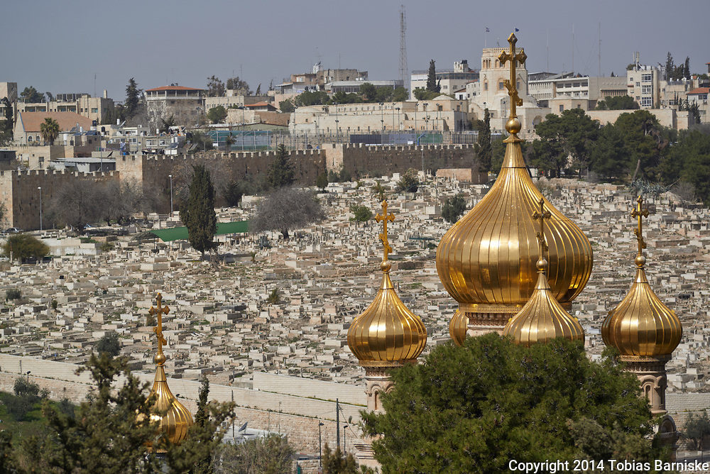 The domes of the Church of Mary Magdalene at the Mount of Olives, in the background the old town of Jerusalem.