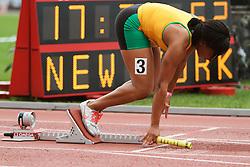 Girls 4x100 meter relay, sprinter in blocks
