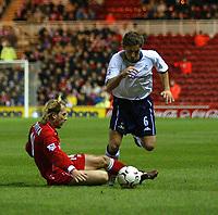 Photo. Andrew Unwin.<br /> Middlesbrough v Tottenham Hotspurs, Barclaycard Premier League, Riverside Stadium, Middlesbrough 09/03/2004.<br /> Tottenham's Michael Brown (r) hurdles the challenge of Middlesbrough's Gaizka Mendieta (l).