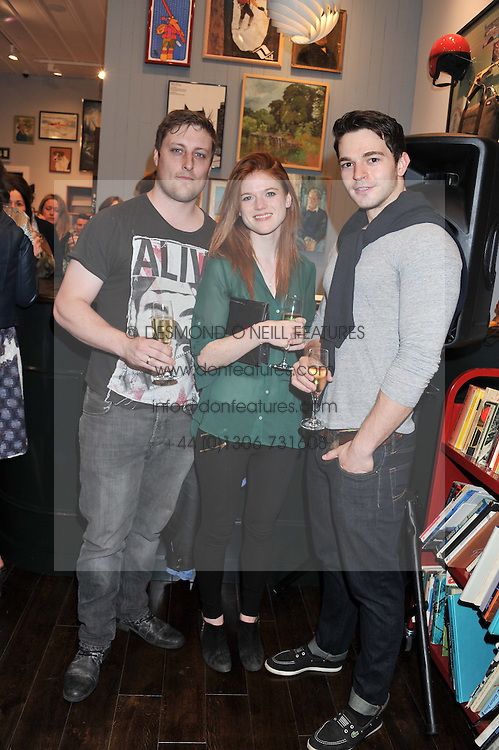 Left to right, actors HAYDN CARROLL, ROSE LESLIE and DOMINIC ALLBURN at the opening of the new Jack Spade store at 83 Brewer street, London on 29th March 2012.