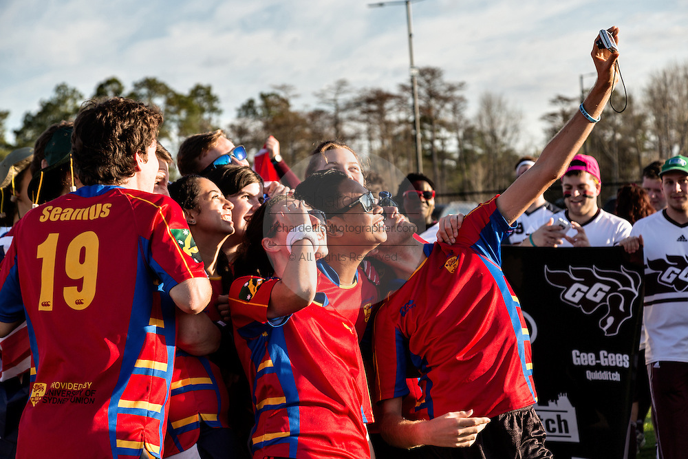Members of the University of Sydney Australia team take a selfie during the opening ceremonies for the 7th Annual Quidditch World Cup April 5, 2014 in Myrtle Beach, South Carolina. The sport, created from the Harry Potter novels is a co-ed contact sport with elements from rugby, basketball, and dodgeball. A quidditch team is made up of seven athletes who play with broomsticks between their legs at all times.