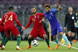 (L-R) Joao Cancelo of Portugal, Ricardo Quaresma of Portugal, Tonny Vilhena of Holland during the International friendly match match between Portugal and The Netherlands at Stade de Genève on March 26, 2018 in Geneva, Switzerland