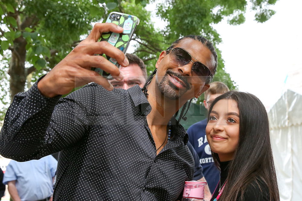 © Licensed to London News Pictures. 17/07/2019. London, UK. British DAVID HAYE takes a selfie with a boxing fan near City Hall. Photo credit: Dinendra Haria/LNP