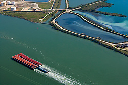 Aerial view of a barge travelling through the Port of Houston
