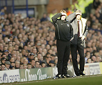 Photo: Aidan Ellis.<br /> Everton v Arsenal. The Barclays Premiership. 21/01/2006.<br /> Everton's David Moyes and Arsenal's Arsene Wenger struggle to see the game in the bright sunlight