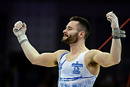 James Hall of Great Britain on the horizontal bar celebrates during the The Superstars of Gymnastics event at the O2 Arena, London, United Kingdom on 23 March 2019.