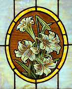 Stained glass window of Easter Lilies.  Minneapolis Minnesota USA